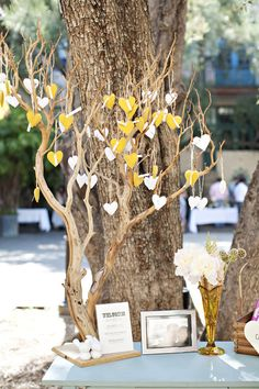 GORGEOUS felt heart festooned tree! #wedding #decor
