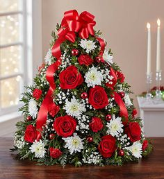 Shop Christmas flowers & gifts for delivery to celebrate the season! Find beautiful Christmas floral arrangements and holiday flowers. Tabletop Christmas Tree, Small Christmas Trees, Christmas Greenery, Christmas Flowers, Christmas Candles, Christmas Flower Arrangements, Christmas Centerpieces, Christmas Tree Decorations, Floral Arrangements