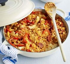 A Cajun-inspired rice pot recipe with spicy Spanish sausage, sweet peppers and tomatoes