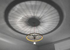 It might be tough to DIY, but this pendant bike rim lamp is pleasant to look at.