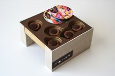 Designed by Valentina Llorente , Venezuela .   Chocolart Galerie is both an exclusive chocolaterie and an art gallery; the store and packag...