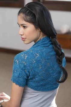 Skeins / Yardage needed for sizes: 2 (3, 3, 4, 5, 5) hanks - 360 (540, 540, 720, 900, 900) yardsWorked from the center out, this lacy shrug is the perfect accessory to wear all year.The yak and bamboo blend will keep you warm despite the lace. And the seamless construction makes this project fun to knit as well as fun to wear.Notes Back of Shrug is a square worked from the center out, with sleeves and ribbing added last. Yarn has unusual drape, blocking the Back before adding Sleeves is…
