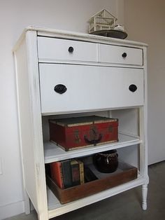 Great example for  use of old chest with missing or broken drawers...turn into bookcase or open shelves for storage.