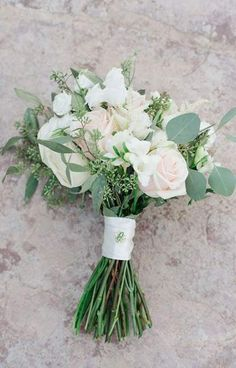 This elegant-yet-natural bouquet features trailing eucalyptus amongst the roses, ranunculus, and hydrangeas. Isn't this a perfect bouquet for a garden wedding? Bouquet D'eucalyptus, Ranunculus Wedding Bouquet, Eucalyptus Bouquet, Eucalyptus Wedding, Bride Bouquets, Eucalyptus Leaves, Herb Bouquet, Flower Bouquets, Hydrangea Bridesmaid Bouquet