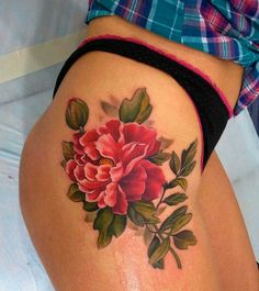 Beautiful flower tattoo on hip