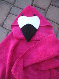 Flamingo is bubblegum pink with a black and white beak and black button eyes. This generous sized bird is made with a 30 x 54 bath towel to fit ages 4 and up. Hood is about 11 1/2 from top of head to body (laying flat). Flamingo will arrive at your home folded neatly and tied with a
