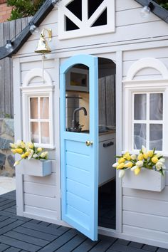 Sweet cubby for a boy with blue door and yellow tulips. Kmart hack cubby painted grey with bright blue door.