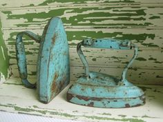 Fabulous pair of number 7 Antique Cast Iron Clothes Irons. These are painted a magnificent aqua blue. Time has aged these to shabby chic perfection.