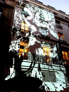The Owl by Victor Ash projected on the facade during the Grand Opening @The Chess Hotel