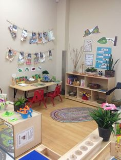 i want to have a sort of classroom/play area/art studio for my kids-This room is bright and appealing to children.
