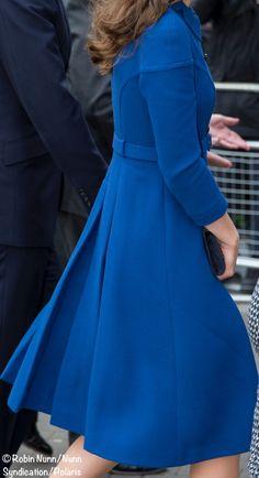 Cobalt blue coat-dress has slight empire waist.