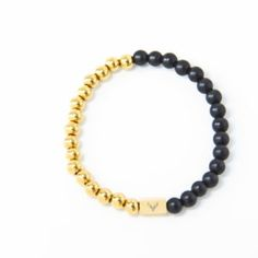 Accessories for the modern man who pays attention to details. Men's beaded bracelet with white black matte onyx & gold stainless steel beads.