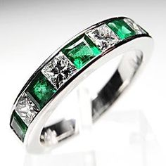 This magnificent wedding band ring features alternating square cut natural emeralds and diamonds set in solid platinum