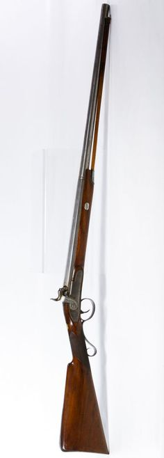 "Lot 402: British Black Powder Shotgun; Having ""J. Cooper"" etched above the trigger, a ramrod and a mahogany stock"