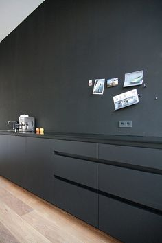 :: KITCHENS :: Matte, all-black kitchen instead of the usual all-white ones. Photo Credit: MO Architekten. - lovely, simple timeless #kitchens #MOArchitekten