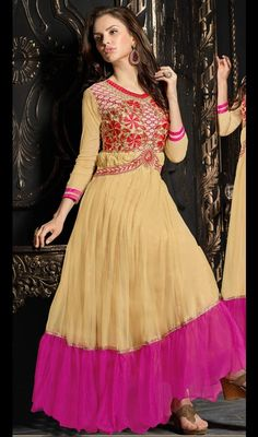 Appear stunningly beautiful in such a beige and pink net flared long Anarkali churidar suit. Beautified with lace and resham work. #LatestAnarkaliCasualSuit