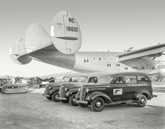 """Aug. 28, 1939. """"Golden Gate International Exposition, San Francisco. General Motors exhibit of GMC trucks with Pan American Airways Clipper Ship at Treasure Island. Bay Bridge in background."""" The Boeing 314 flying boat Honolulu Clipper. 8x10 Agfa negative from the Wyland Stanley collection."""