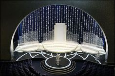 This is an example of elevated horizontal element that define space. This picture is a miniturized model of a conference hall. The circular elevated flatform indicates a space for the speaker.