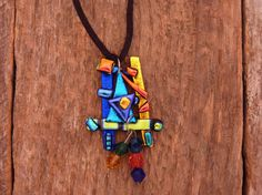 """Dichroic Fused Glass Necklace with Chrystal Beads on an 18"""" Black Cord. Pendant measures 1 1/4"""" x 2 1/4"""". $40.00, via Etsy."""