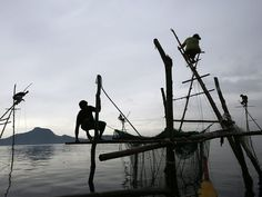 People fish with nets off Anibong, Leyte province, Philippines