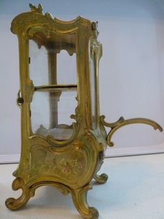"Antique French Brass Sedan Chair Vitrine Display.   ""She came home in a flood of tears and a sedan chair"""