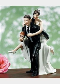 """If you and your beloved are Football fans, you'll love this cake topper. Beautifully styled with exquisite detailing, this playful couple is destined to score a """"touch down"""" on your big day.   Hand painted porcelain.  Cake Topper measures 5.5 inches high with a base of 2.75 inches.  Topper weights 5.6 ounces."""
