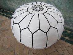 White pouf with black stitching