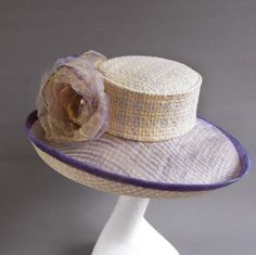 Soft yellow and lavender sinamay derby / church hat size 57,5 with optional but included ton sur ton flowers Materials: passion, bouclé fabric, flowers, basked weaved sinamay
