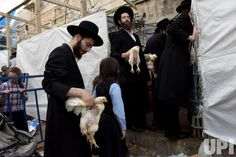 Ultra-Orthodox Jewish hold chickens after performing the 'Kapparot' ceremony in Mea Shearim in Jerusalem, Israel, October 10, 2016. The Jewish ritual symbolically transfers the sins of the past year to the chicken and is performed before Yom Kippur, the Day of Atonement, the holiest day in the Jewish calendar. Yom Kippur starts at sunset on October 11 this year.