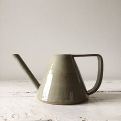 Handmade ceramic watering can. Hand-thrown on the wheel and finished using   hand-building methods.    Grey clay with a white interior, clear exterior and raw edge accents.    Holds approximately 500ml of water.