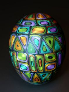 "I call this a jeweled egg because the metallic/pearlescent clay reflects light like jewels. I made it for a class I am teaching called ""Jeweled Eggs and Beads"""
