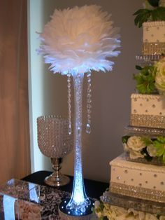 Aglow Weddings & Events. One of our favorites. Our feather ball centerpieces.