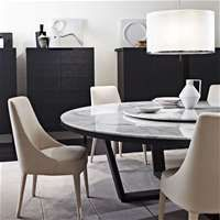Antonio Citterio made for Maxalto dining room table. B&B Italia brand.  1/2013 ad in Arch. Digest of white oblong marble-topped table with a chrome X-leg design.  But I like the one with wood legs here, too.  One is called Pathos as the collection name.