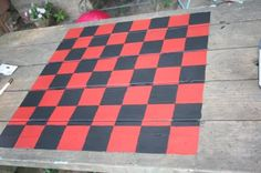 checkerboard on a wooden picnic table