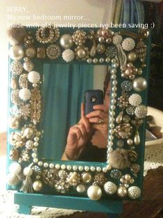 A mirror decorated with old costume jewelry