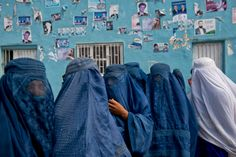 Lynsey Addario for TIME Afghan women leave an election rally at a stadium in Mazar-i-Sharif, Afghanistan, March 27, 2014.