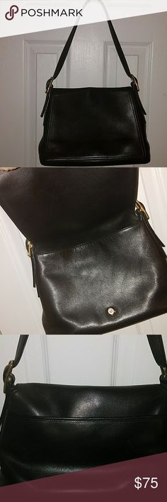 Coach Classic Black One of the most beautiful black leather Coach purses I have seen in a while. Pristine condition and sophisticated -sleek-professional and just perfect for any occasion. Coach Bags Shoulder Bags