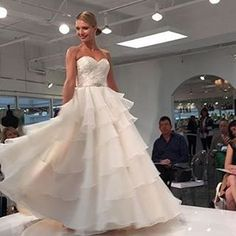A sneak peek from bridal market of what @morileeofficial has in store for brides with their new Spring 2016 collection!! We are smitten with the skirt on this gown. #MoriLee #sneakpeek #excited #bridalmarket #comingsoon #bridalgown #weddingdress #bride #b
