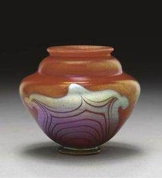 A DECORATED RED FAVRILE GLASS VASE   TIFFANY STUDIOS, CIRCA 1917   3¼in. (8.3cm.) high   engraved 9923L L.C. Tiffany-Favrile