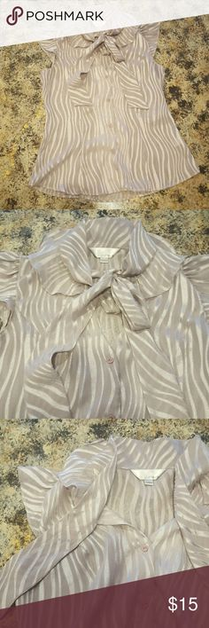 🎀New Listing! Lovely boutique blouse with scarf Zoa is a contemporary women's line specializing in silk, lace, and delicate tops. This top is truly unique with flutter cap sleeves, button front, V-neck, ruffled collar, and a  scarf which can be worn in a bow, as a tie, or loosely knotted...you decide!   100% rayon. It is sheer but with a nude bra and a blazer it doesn't require a camisole. The color is lilac with silver shimmery ribbon in a zebra-like pattern. I hate to part with it I just…