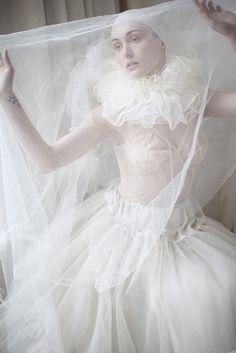 She had decided the best way not to clash with the decor of the Ball was to wear white, and lots of it.