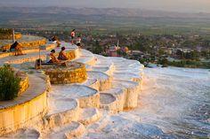 Travertine terrace formations and tourists. Pamukkale. Denizli province. Anatolia. Turkey.