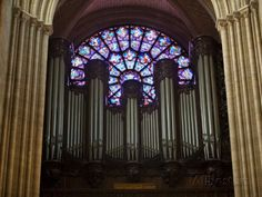Detail of Notre Dame Cathedral Pipe Organ and Stained Glass Window, Paris, France Photographic Print by Jim Zuckerman at AllPosters.com
