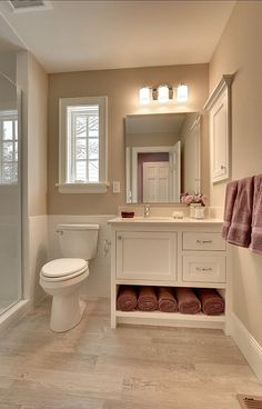 "I like how this set of cabinets leaves room for towels incase you don't have a closet in the bathroom. Storing the towels below isn't just functional, it adds a splash of color to the room and makes it feel ""cozy""."