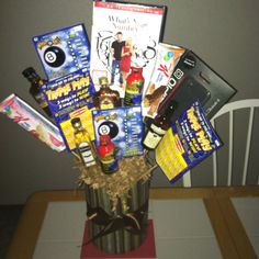 Man bouquet I made for my husband. Vase with fake flower styrofoam and wood kabob sticks. Some of my hubbys favorite things pasted on with my hot glue gun.