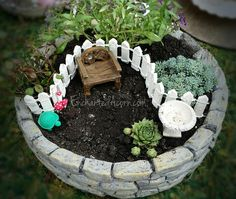 "Small-scale miniature garden with alyssum and sedum ""bushes"" and small hens and chicks ""plants"" by EnchantedAcorn.com"
