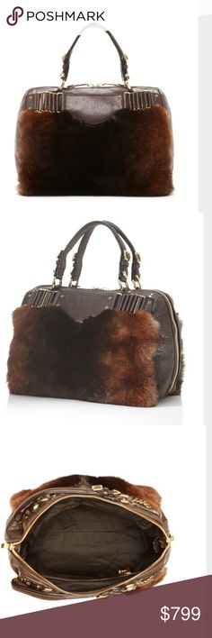 """Rebecca Minkoff Collection Rebecca Minkoff Houston Satchel  Accent your winter style with this fur bag.  - Dual top handles - 2-way zip-around closure - Front and back genuine rabbit fur panels with buckle and woven chain accents - Exterior features metal feet - Interior features wall zip pocket, card slot, key clasp, and 2 slip pockets - Approx. 8.5"""" H x 12.5"""" W x 7"""" D - Approx. 5"""" handle drop - Imported Materials Leather and rabbit fur (origin: China) exterior, fabric lining Rebecca…"""