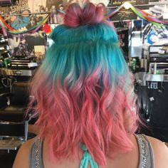 Half bun Pastel color hair updo with blue green roots and pink tips