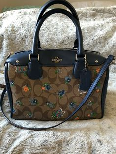 7f1dfd0a2a73 COACH Brown Mini Bennett Purse With Blue Trim Floral Pattern and Strap.   fashion
