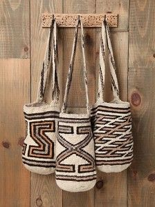 Mochilas - Sustainably crafted by indigenous tribes high in the mountains of nothern Colombia, mochilas are virtually unbreakable shoulder bags that very popular all over the country.  They are miraculously made using entirely natural products and as with molas, each design depicts the spirituality and cosmology of the #indigenous artists. A mochila is a practical, stylish and downright awesome souvenir to buy in Colombia.